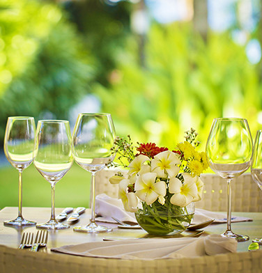 outdoor garden table setting with orchid flower arrangement