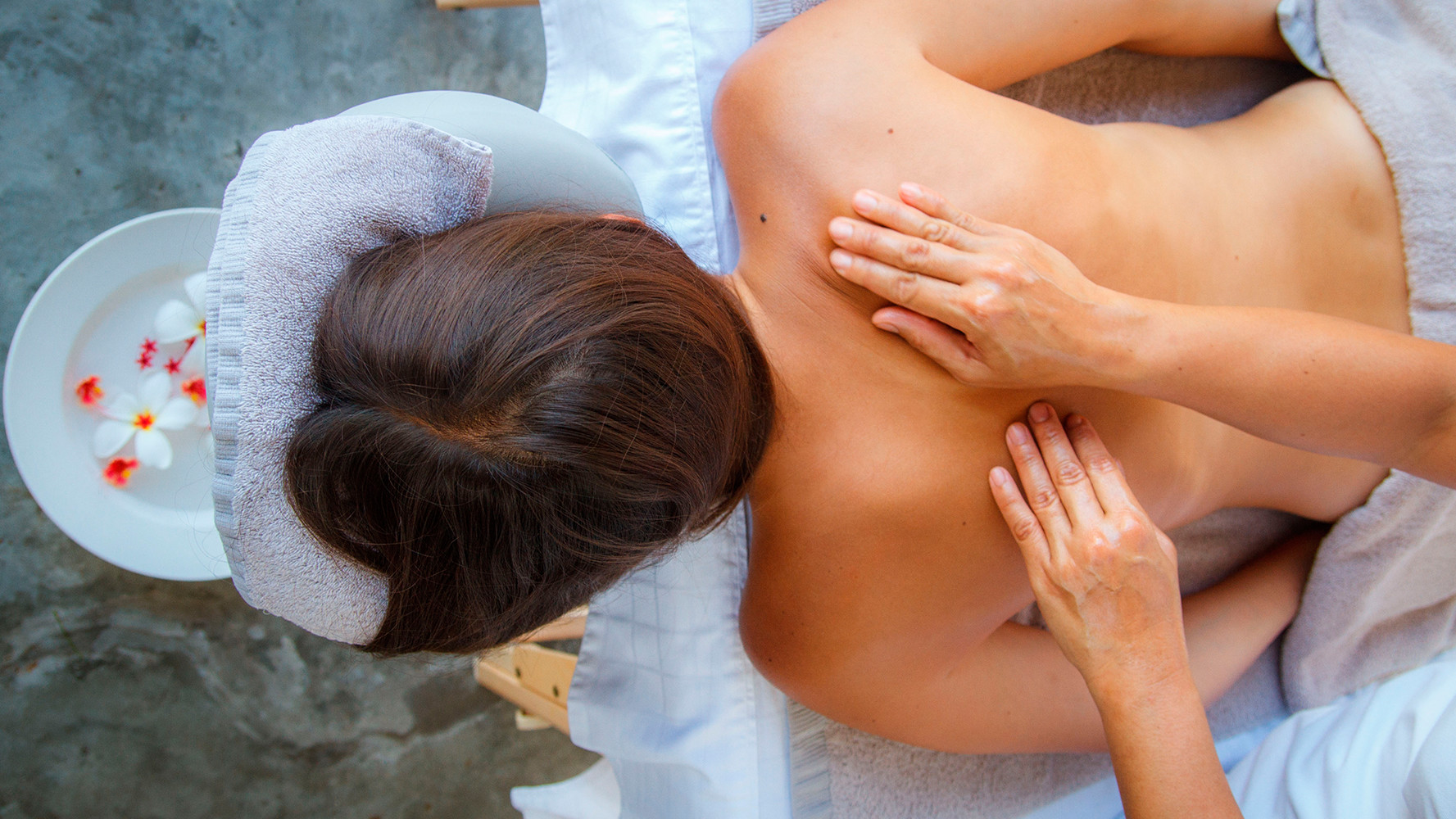 oriental girl having a luxury thai massage
